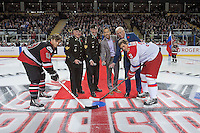 KELOWNA, CANADA - NOVEMBER 9: Military officials, Mayor Colin Basran and Kelowna Rockets GM Bruce Hamilton line up for the ceremonial puck drop between Brayden Point #19 of team WHL and Ilya Dervuk # 3 of team Russia on November 9, 2015 during game 1 of the Canada Russia Super Series at Prospera Place in Kelowna, British Columbia, Canada.  (Photo by Marissa Baecker/Western Hockey League)  *** Local Caption *** Mayor Colin Basran; Bruce Hamilton; Ilya Dervuk; Brayden Point;