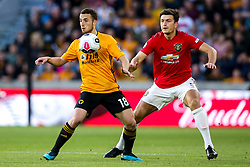 Diogo Jota of Wolverhampton Wanderers takes on Harry Maguire of Manchester United - Mandatory by-line: Robbie Stephenson/JMP - 19/08/2019 - FOOTBALL - Molineux - Wolverhampton, England - Wolverhampton Wanderers v Manchester United - Premier League
