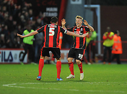 Bournemouth's Matt Ritchie celebrates with Bournemouth's Tommy Elphick after scoring. - Photo mandatory by-line: Alex James/JMP - Tel: Mobile: 07966 386802 26/12/2013 - SPORT - FOOTBALL - Goldsands Stadium - Bournemouth - AFC Bournemouth v Yeovil Town - Sky Bet Championship