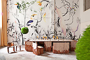 Patricia Urquiola (GAN) 'Mangas Pouff', Pablo Piatti 'Tropical Birds' wallpaper mural (Tres Tintas Barcelona), Max Lamb (Johnson Trading Gallery) chair and stool, Ovando: Floral Design and Event Production Hanging Trees, Alex Gil (Spacecutter) 'Monolith' dining table, assorted ceramics by Melissa Gamwell and Natalia Criado