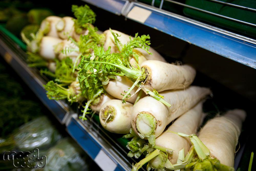 Close-up of radishes on shelf in supermarket