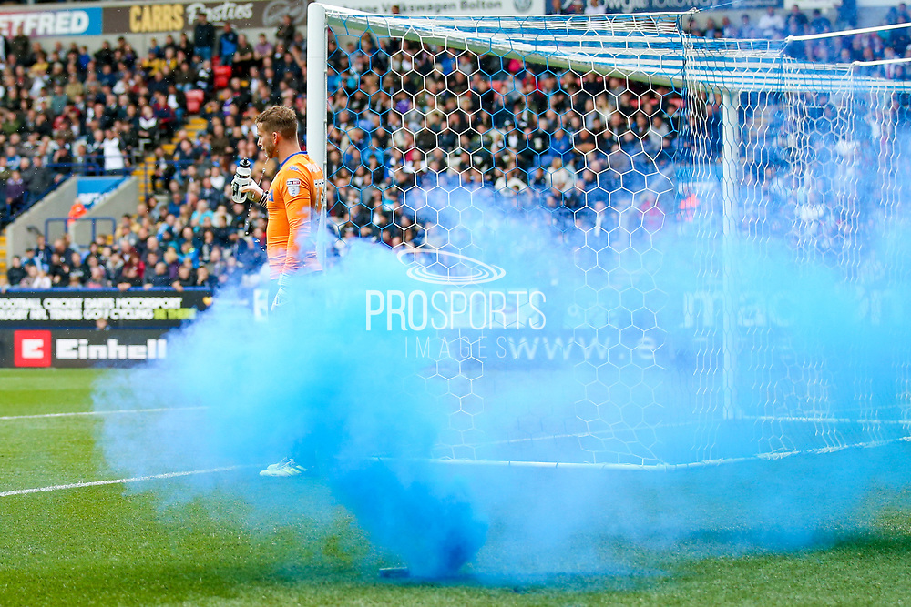 Leeds United celebrate with throwing a flare onto the pitch  during the EFL Sky Bet Championship match between Bolton Wanderers and Leeds United at the Macron Stadium, Bolton, England on 6 August 2017. Photo by Simon Davies.