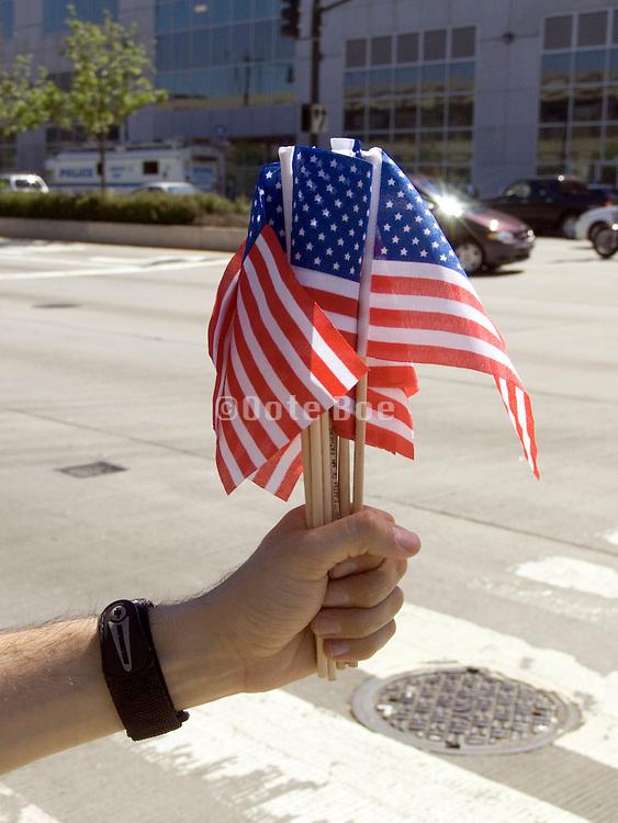 distributing small American flags during Fleet week 2005 NYC