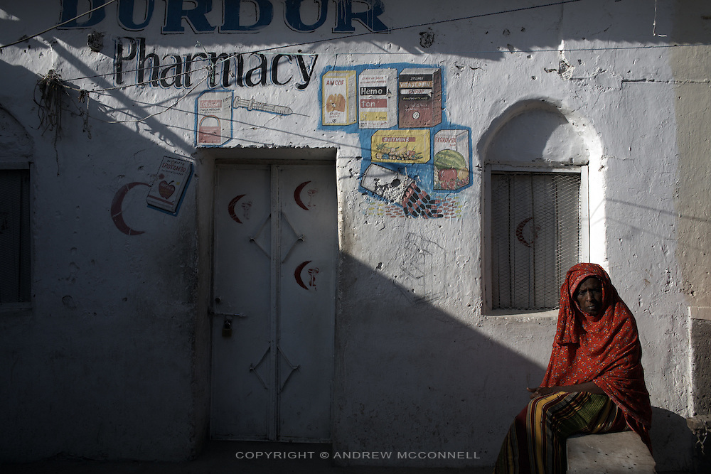A woman waits for a pharmacy to open in Hargeisa, Somaliland.