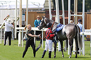 Jockey Ben Curtis dismounts Najashee after The 30 Year Curzon Club York Anniversary Stakes over 1m 2f (£15,000)  during the John Smiths Cup Meeting at York Racecourse, York, United Kingdom on 12 July 2019.