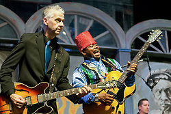30 April 2015. New Orleans, Louisiana.<br /> The New Orleans Jazz and Heritage Festival. <br /> Lil' Ed (rt) and Mike Garrett and band the Blue Imperials having fun on the Blues stage.<br /> Photo; Charlie Varley/varleypix.com