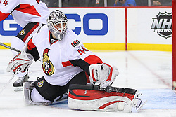 Dec 18, 2013; Newark, NJ, USA;  Ottawa Senators goalie Robin Lehner (40) makes a save during the second period of their game against the New Jersey Devils at the Prudential Center.