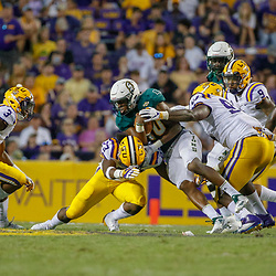 Sep 8, 2018; Baton Rouge, LA, USA; LSU Tigers linebacker Micah Baskerville (23) tackles Southeastern Louisiana Lions runner Lorenzo Nunez (10) during the second quarter of a game at Tiger Stadium. Mandatory Credit: Derick E. Hingle-USA TODAY Sports