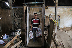 59645972  . A man comes up from the underground tunnel beneath the Gaza-Egypt border with KFC food in the southern Gaza Strip city of Rafah on May 15, 2013. Ordering fast food from one of the world s most popular restaurants KFC has become possible in Gaza after Al-Yamama delivery company started to bring the food from the Egyptian north Sinai, which borders Gaza, May 15, 2013. Photo by: imago / i-Images. UK ONLY