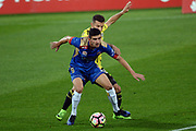Newcastle Jets' player Steven Ugarkovic and Phoenix's Kosta Barbarouses involve in a dribble challenge during the Hyundai A-League, Wellington Phoenix v Newcastle Jets, Westpac Stadium, Wellington, Sunday 26th March 2017. Copyright Photo: Raghavan Venugopal / www.photosport.nz