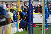 AFC Wimbledon attacker Shane McLoughlin (19) ends up in the stands after chasing a ball during the EFL Sky Bet League 1 match between AFC Wimbledon and Bolton Wanderers at the Cherry Red Records Stadium, Kingston, England on 7 March 2020.