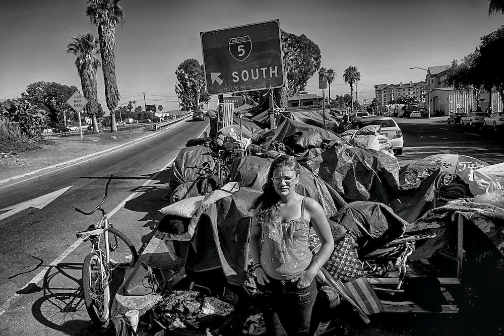 Stephanie Fulkerson, 29, who is homeless, stands in front of her camp in downtown San Diego, California on Wednesday, July 13, 2016. Police recently arrested Jon David Guerrero, who authorities believ is responsible for murdering 3 homeless vicitms and injusting several others which has kept the homeless community on edge.(Photo by Sandy Huffaker/Zuma Press)