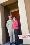 Senior couple standing in doorway