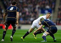 England Winger (#14) Chris Ashton (Saracens) is tackled by Scotland Flanker (#7) Kelly Brown (Saracens, capt) during the first half of the match - Photo mandatory by-line: Rogan Thomson/JMP - Tel: Mobile: 07966 386802 02/02/2013 - SPORT - RUGBY UNION - Twickenham Stadium - London. England v Scotland - 2013 RBS Six Nations Championship. The winner of this fixture is awarded the Calcutta Cup.