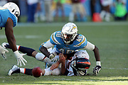 Los Angeles Chargers defensive end Chris McCain (40) looks for the loose ball with a teammate after a strip sack fumble by Denver Broncos quarterback Trevor Siemian (13) during the 2017 NFL week 7 regular season football game against the Denver Broncos, Sunday, Oct. 22, 2017 in Carson, Calif. The Chargers won the game in a 21-0 shutout. (©Paul Anthony Spinelli)