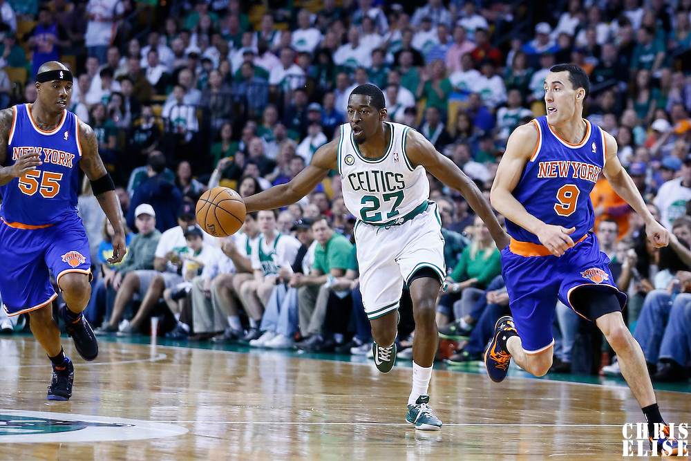 28 April 2013: Boston Celtics shooting guard Jordan Crawford (27) brings the ball upcourt past New York Knicks point guard Pablo Prigioni (9) during Boston Celtics overtime 97-90 victory over the New York Knicks during Game Four of the Eastern Conference Quarterfinals of the 2013 NBA Playoffs at the TD Garden, Boston, Massachusetts, USA.