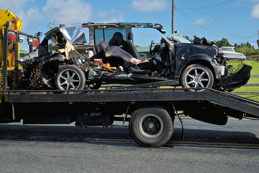 A woman in the car was trapped and died at the scene after her car and a truck collided on the Riverhead-Coatesville Highway, Kumeu, Auckland New Zealand, Monday, April 21, 2014. Credit:SNPA / Bradley Ambrose