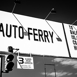 Balboa Island Ferry sign black and white picture. Located in Newport Beach California, the Balboa Island auto ferry carries cars and people from Balboa Peninsula across Newport Harbor to Balboa Island.