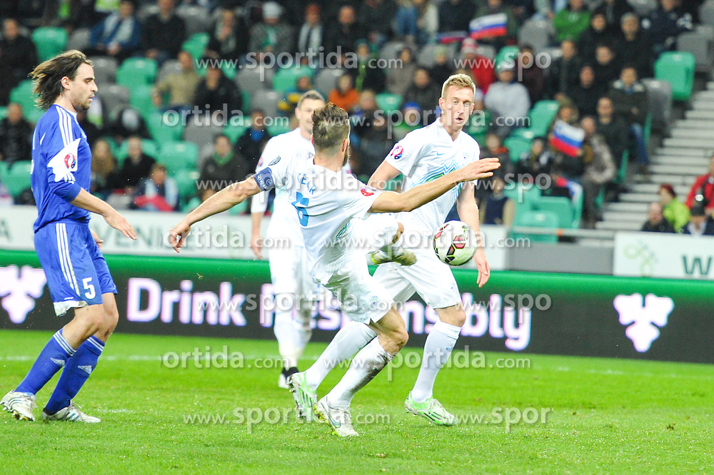 Bostjan Cesar, Robert Beric during football match between NationalTeams of Slovenia and San Marino in Round 5 of EURO 2016 Qualifications, on March 27, 2015 in SRC Stozice, Ljubljana, Slovenia. Photo by Mario Horvat / Sportida