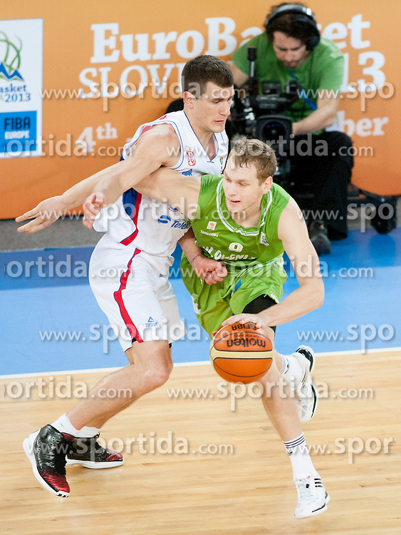 Jaka Blazic of Slovenia vs Nemanja Nedovic #4 of Serbia during basketball match between National teams of Serbia and Slovenia in ranking of 5th to 8th place at Day 16 of Eurobasket 2013 on September 19, 2013 in SRC Stozice, Ljubljana, Slovenia. (Photo By Urban Urbanc / Sportida)