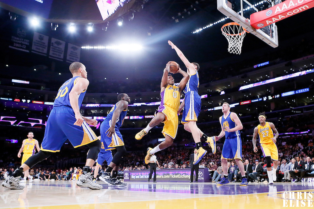11 April 2014: Los Angeles Lakers forward Nick Young (0) goes for the layup against Golden State Warriors guard Klay Thompson (11) during the Golden State Warriors 112-95 victory over the Los Angeles Lakers at the Staples Center, Los Angeles, California, USA.