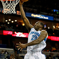 December 21, 2011; New Orleans, LA, USA; New Orleans Hornets small forward Quincy Pondexter (20) shoots against the Memphis Grizzlies during the second half of a preseason game at the New Orleans Arena. The Hornets defeated the Grizzlies 95-80.  Mandatory Credit: Derick E. Hingle-US PRESSWIRE
