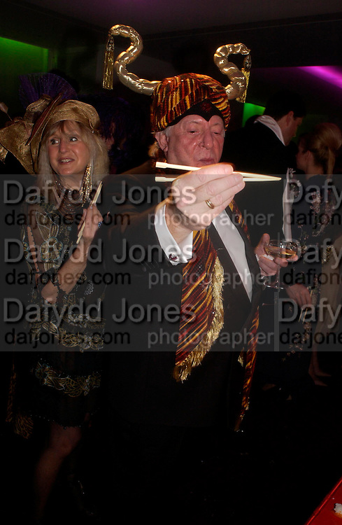 Liz Brewer and Terence Cole  Andy & Patti Wong's Chinese New Year party to celebrate the year of the Rooster held at the Great Eastern Hotel, Liverpool Street, London.29th January 2005. The theme was a night of hedonism in 1920's Shanghai. . ONE TIME USE ONLY - DO NOT ARCHIVE  © Copyright Photograph by Dafydd Jones 66 Stockwell Park Rd. London SW9 0DA Tel 020 7733 0108 www.dafjones.com