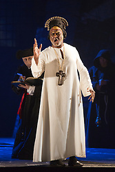 "© Licensed to London News Pictures. 02/06/2014. London, England. Willard White as Pope Clement VII. Dress rehearsal of the Hector Berlioz opera ""Benvenuto Cellini"" at the London Coliseum. Directed by Monty Python and movie director Terry Gilliam for the English National Opera. Benvenuto Cellini opens on 5 June for 8 performances. As part of ENO Screen, the opera will be broadcast live to over 300 cinemas in the UK and Ireland and selected cinemas worldwide on 17 June 2014. Co-production with De Nederlandse Opera, Amsterdam and Teatro dell'Opera di Roma. Michael Spyres as Benvenuto Cellini, Pavlo Hunka as Balducci, Corinne Winters as Teresa, Nicholas Pallesen as Fieramosca and Willard White as Pope Clement VII. Photo credit: Bettina Strenske/LNP"