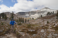 A backpacker climbs the trail from Glacier Lake, as he heads toward Glacier Pass, Eagle Cap Wilderness, Oregon