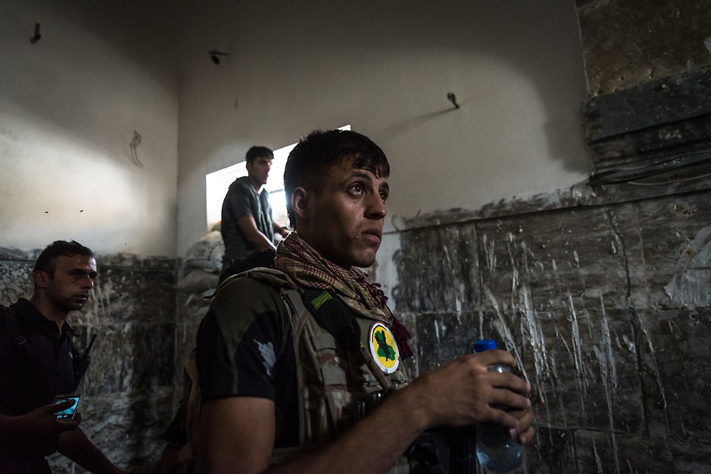 Soldiers of the Iraqi Special forces take cover from an airstrike inside a mosque in the Old City of Mosul.