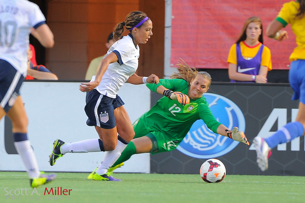 U.S. forward Sydney Leroux (2) goes around Brazil goalkeeper Luciana (12) to score during an international friendly against Brazil at the Florida Citrus Bowl on Nov. 10, 2013 in Orlando, Florida. <br /> <br /> &copy;2013 Scott A. Miller
