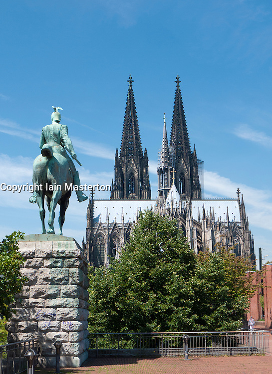 Kaiser statue and Cathedral or Dom in Cologne Germany