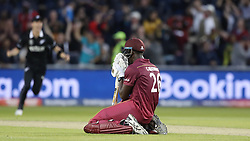 West Indies Carlos Brathwaite drops to his knees as he caught on the boundary during the ICC Cricket World Cup group stage match at Old Trafford, Manchester.