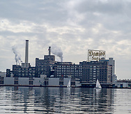 Baltimore, MD, USA --April 13, 2019-- Photo of a Domino Sugar plant with working smokestacks located on the inner harbor of Baltimore Maryland.