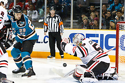 December 11, 2010; San Jose, CA, USA; Chicago Blackhawks goalie Corey Crawford (50) saves a shot from San Jose Sharks right wing Ryane Clowe (29) during the second period at HP Pavilion. Mandatory Credit: Jason O. Watson / US PRESSWIRE
