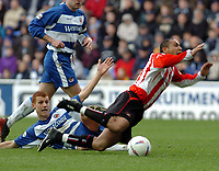Picture: Henry Browne.<br />Date: 20/03/2004.<br />Reading v Sunderland Nationwide First Division.<br /><br />Steve Sidwell of Reading brings down Sunderland's Jeff Whitley, but no penalty is awarded.