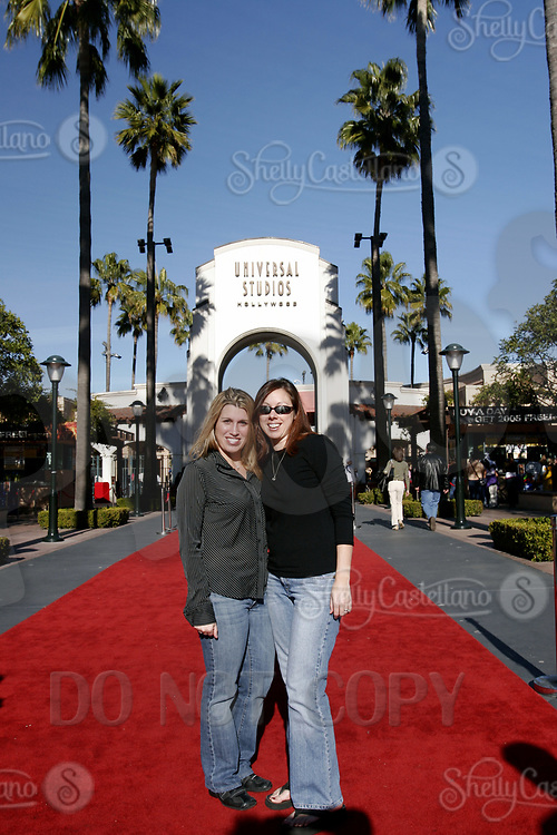 Jan 15, 2005; Hollywood, CA, USA; Visitors have their photo taken on the red carpet inside the front of Universal Studios Theme Park in Hollywood.  Tourist location for thousands of movie and roller coaster fans traveling and visiting Southern California.  Theme Park includes roller coaster rides, hollywood movie sets, theme shows and tram tour around sound stages on the property.  Mandatory Credit: Photo by Shelly Castellano/ZUMA Press.