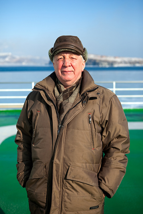 "Portrait of a Russian passenger from Vladivostok on the ""Eastern Dream"" ferry during arrival to the sea port of Vladivostok in Russia. Vladivostok, Russian Federation, Russia, RUS, 12.01.2010."