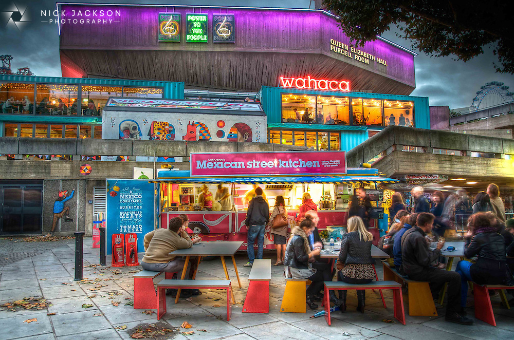 I really enjoy photographing the city at night, capturing the bright lights and vibrant colours. When the Wahaca pop-up restaurant turned up on the Thames Southbank almost overnight I headed straight down there with my camera.<br /> <br /> Crafted out of eight recycled shipping containers, a neon caravan and a lot of fluorescent lighting, the food and people-watching is nearly as good as the photo opportunities. <br /> <br /> It&rsquo;s right in the middle of one of my favourite areas of the Southbank, sitting between the Skate Park, book market and the Festival Hall. There&rsquo;s always something different going on.