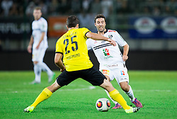 Joachim Standfest of WAC vs Sokratis Papastathopoulos of Borussia Dortmund during football match between WAC Wolfsberg (AUT) and  Borussia Dortmund (GER) in First leg of Third qualifying round of UEFA Europa League 2015/16, on July 30, 2015 in Wörthersee Stadion, Klagenfurt, Austria. Photo by Vid Ponikvar / Sportida