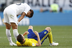 (L-R) Wooyoung Jung of Korea Republic, Marcus Berg of Sweden during the 2018 FIFA World Cup Russia group F match between Sweden and Korea Republic at the Novgorod stadium on June 18, 2018 in Nizhny Novgorod, Russia