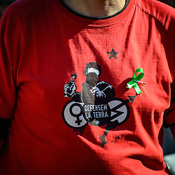 A Proces Constituent supporter wears a shirt that says, ¨defend the land¨, referring to Catalonia.