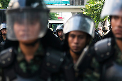 © Licensed to London News Pictures. 24/05/2014. Army in riot gear in formation await anti-coup protestors following a Anti-Coup protest in Bangkok Thailand. The Royal Thai army announced a Military coup and have imposed a 10pm curfew.  Photo credit : Asanka Brendon Ratnayake/LNP