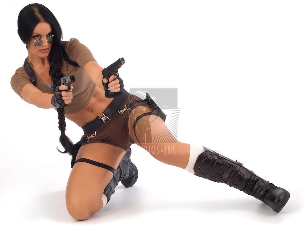 Lara Croft firing pistols on a white background