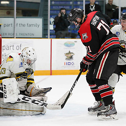 TRENTON, ON  - MAY 5,  2017: Canadian Junior Hockey League, Central Canadian Jr. &quot;A&quot; Championship. The Dudley Hewitt Cup. Game 7 between The Georgetown Raiders and The Powassan Voodoos. Nate McDonald #33 of the Powassan Voodoos makes the save during the second period <br /> (Photo by Amy Deroche / OJHL Images)