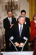 President Bill Clinton with crutches during a White House event, March 26, 1997, where he named a commission to look into Americans concerns about managed health care in Washington, DC.
