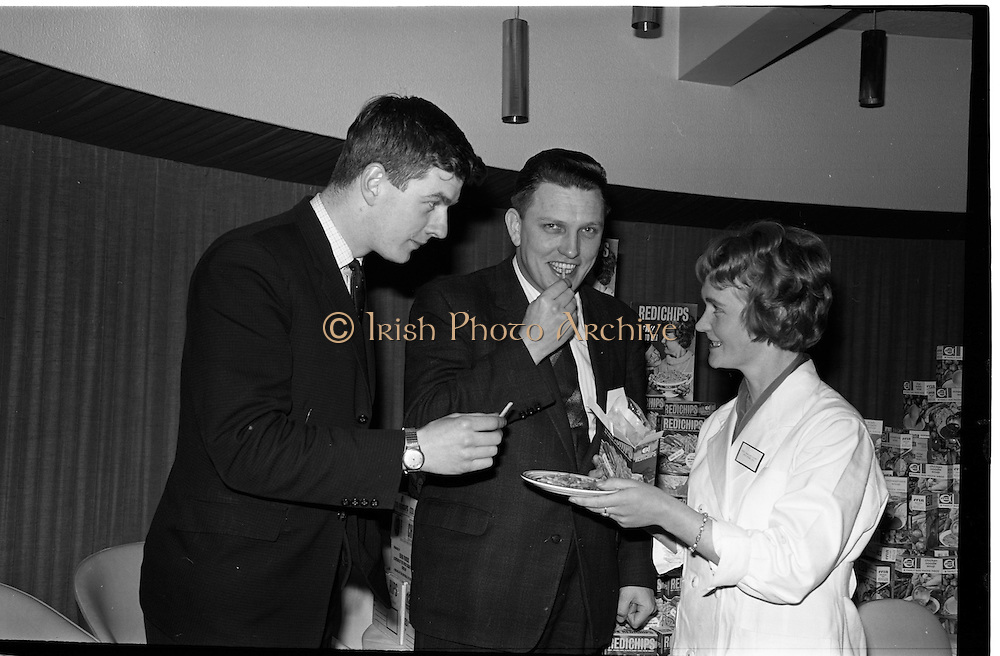 "07/02/1964<br /> 02/07/1964<br /> 07 February 1964<br /> Erin Foods Reception for launch of ""Redichips"" at the Sybaris Club, Abbey Street, Dublin. Pictured are Miss Margaret Scott, (Ballyforan, Ballinasloe) Laboratory Technician, Erin Foods Tuam Factory of the Irish Sugar Co., serving the new Erin ""Redichips"" to Mr William Higgins (Sales Supervisor) and Mr Pat Jones (General Sales Manager) at the launch."