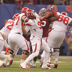 2 January 2009: Utah quarterback Brian Johnson (3) throws a pass during the 75th annual All State Sugar Bowl  between the Utah Utes and the Alabama Crimson Tide at the Louisiana Superdome in New Orleans, LA.