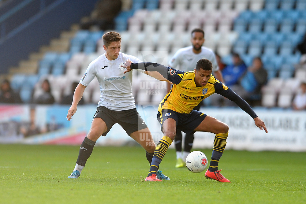 TELFORD COPYRIGHT MIKE SHERIDAN Adam Walker of Telford and Andrai Jones during the Vanarama National League Conference North fixture between AFC Telford United and Guiseley on Saturday, October 19, 2019.<br /> <br /> Picture credit: Mike Sheridan/Ultrapress<br /> <br /> MS201920-026