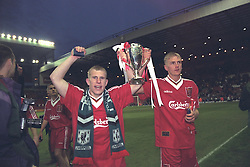 LIVERPOOL, ENGLAND - MAY 1996: Liverpool's Gareth Roberts and Mark Turkington celebrate winning the FA Youth Cup after beating West Ham United during the Final 2nd Leg at Anfield. (Pic by David Rawcliffe/Propaganda)